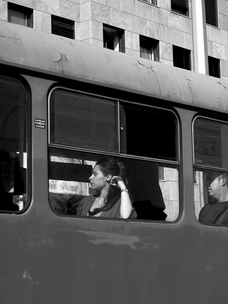 Lady at the windows-bw