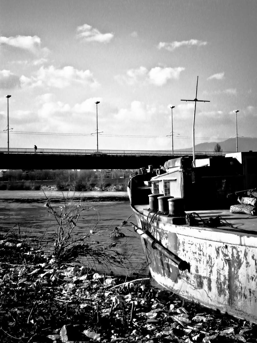 Old boat and faraway stranger