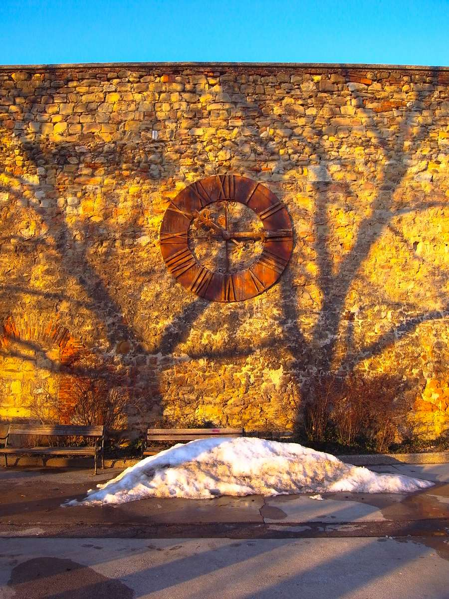 Sunny clock at winters day