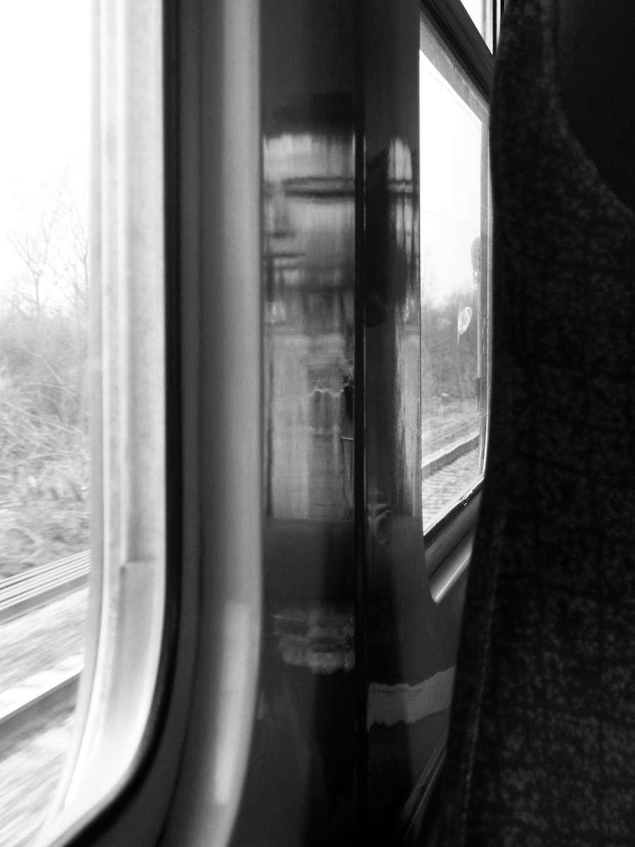 Train girl portrait reflection