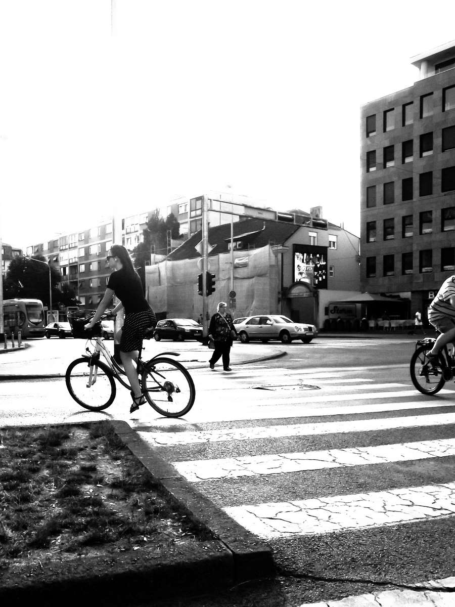 Lovely lady on her bike ion the city