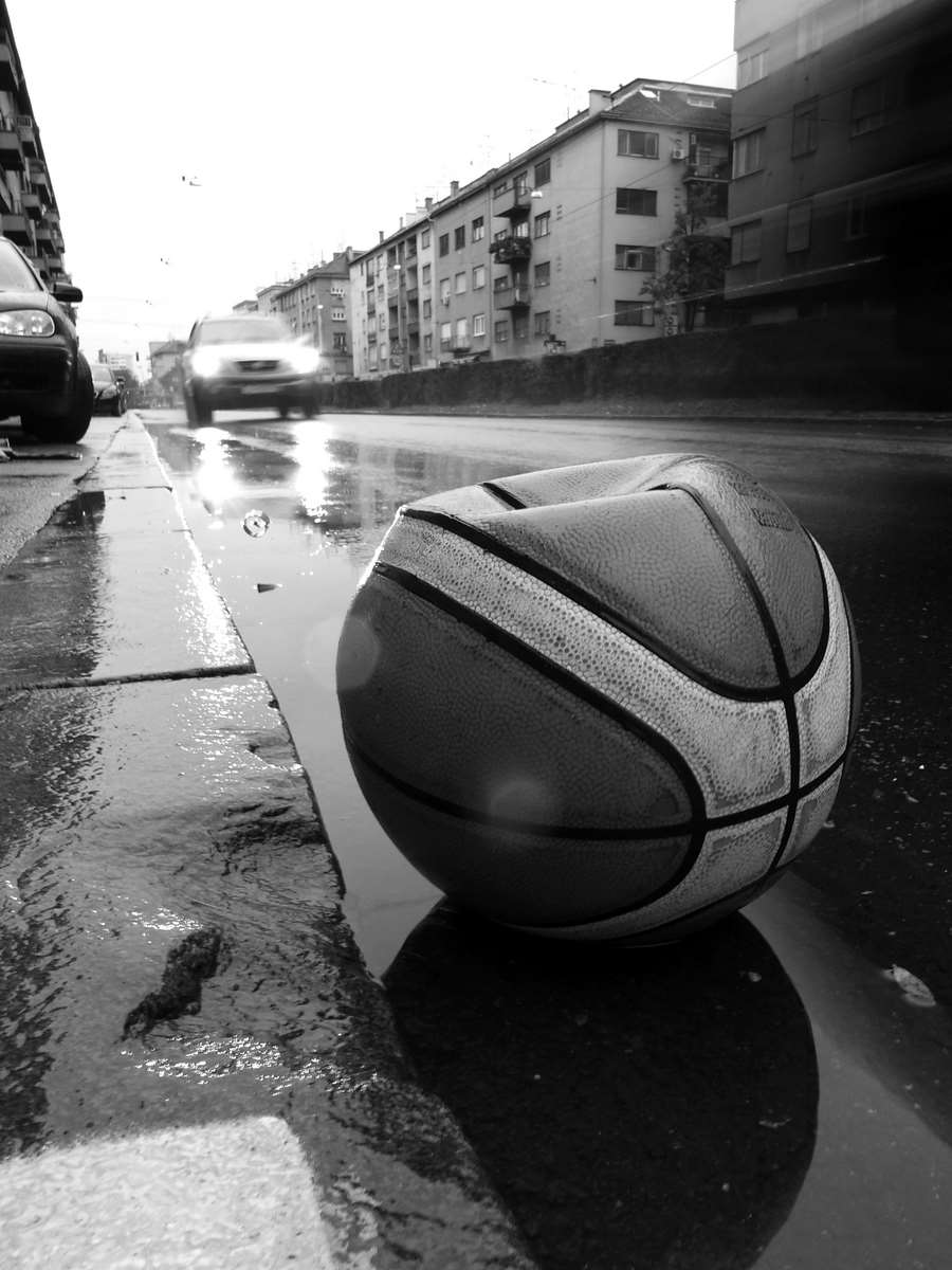 Basket ball at rainy street