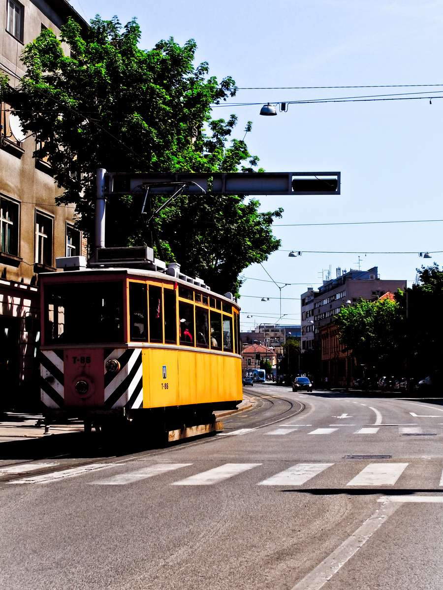 Old tram in old yellow