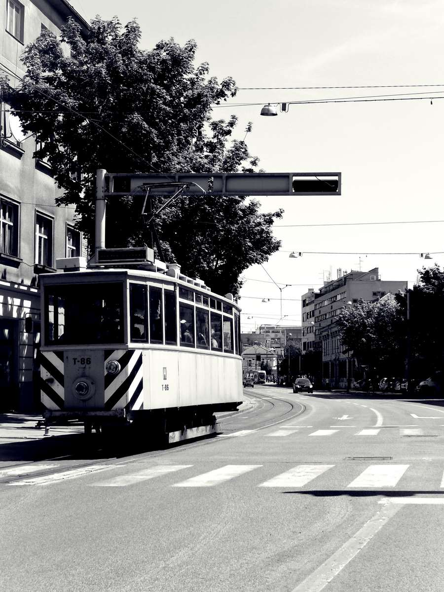 Old tram in old yellow-bw
