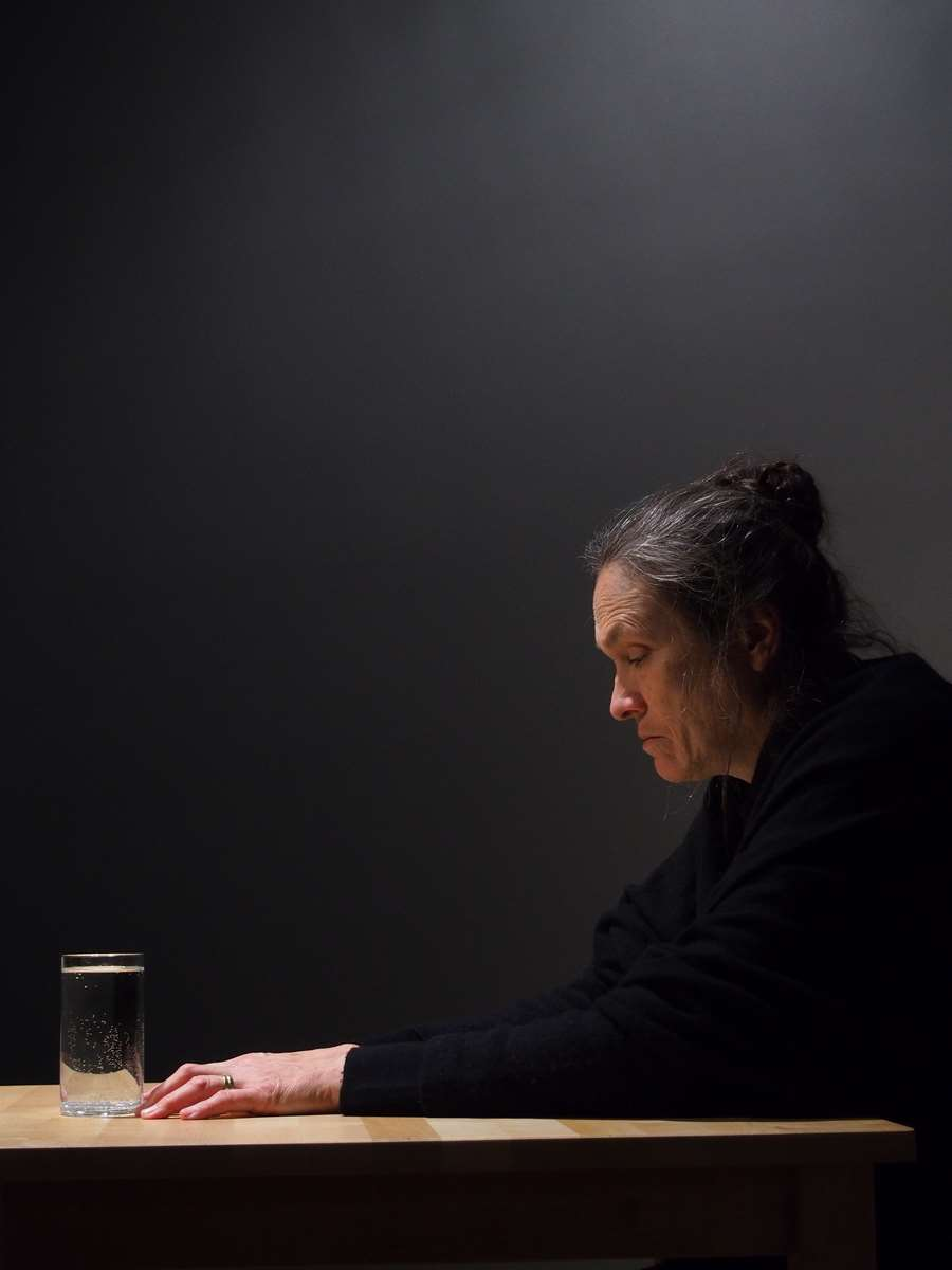 Woman with glasses of water