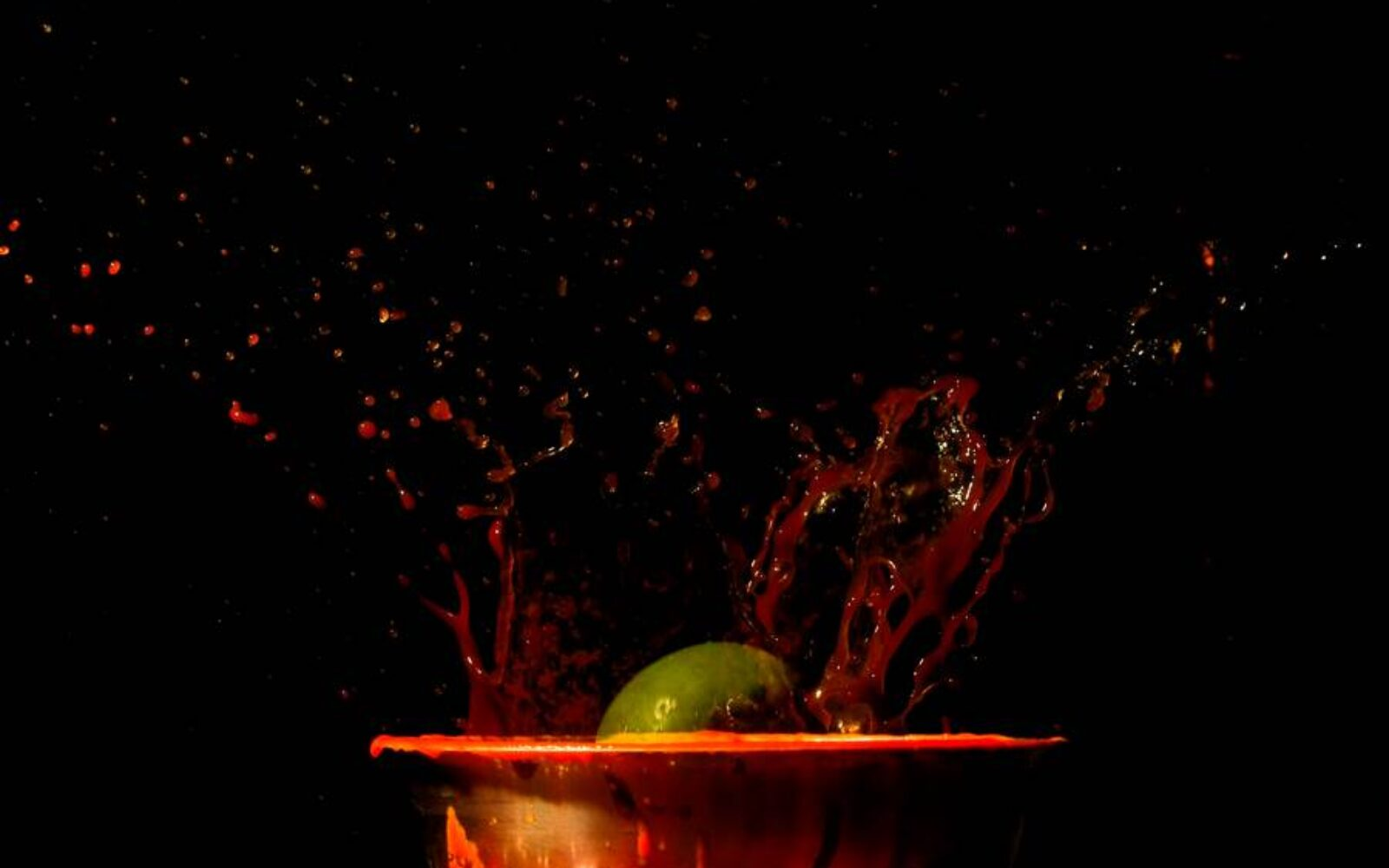 Green splashes red