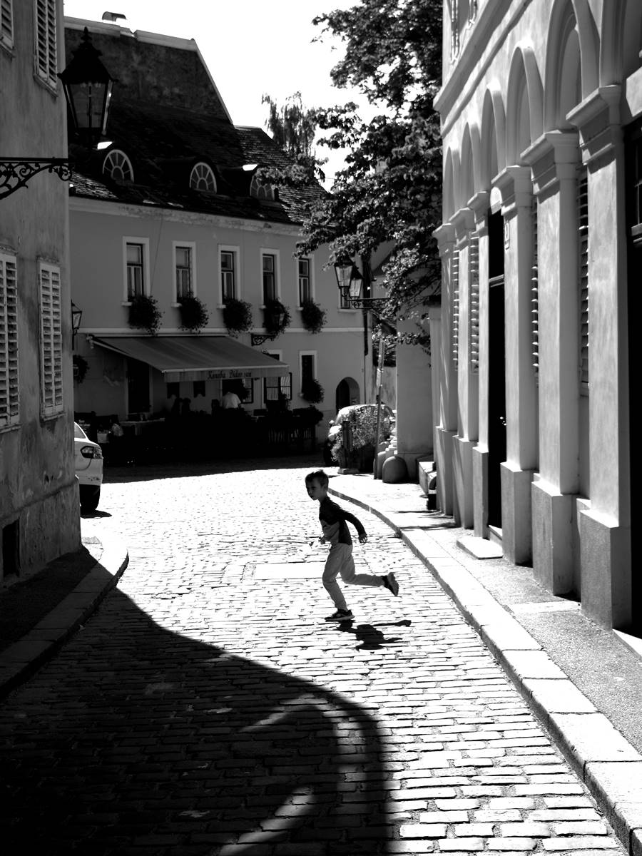 Boy in the summer city shadows